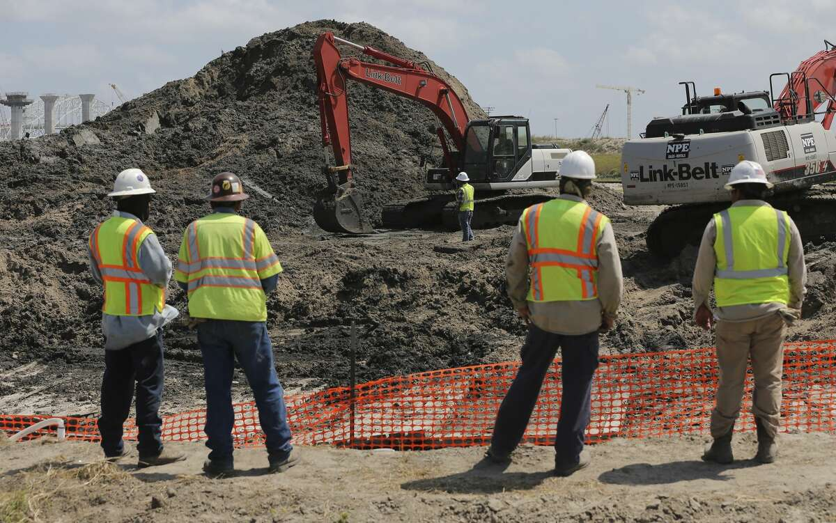 """Work crews oversee the construction for the new """"Cactus 2"""" oil pipeline in Corpus Christi on Tuesday, May 28, 2019. Corpus Christi is becoming a major port for the export of oil from the Permain Basin and The Eagle Ford. One of the big players is NuStar Energy which operates four docks along the Corpus Christi industrial canal. Like many energy storage companies, NuStar is looking forward to the completion of several projects at the canal such as the new Harbor Bridge project which will allow for bigger vessels to pass into the canal and thus can take on more barrels of oil for shipment and a new and larger pipeline which will feed into NuStar's 400-series tank farm. Projects that the new bridge and new pipelines are cementing Corpus Christi as an emerging port of commerce in the energy sector. (Kin Man Hui/San Antonio Express-News)"""