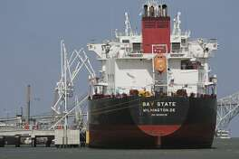 An oil tanker tanks on the transfer of oil from the NuStar Energy facility in Corpus Christi on Tuesday, May 28, 2019. Corpus Christi is becoming a major port for the export of oil from the Permain Basin and The Eagle Ford. One of the big players is NuStar Energy which operates four docks along the Corpus Christi industrial canal. Like many energy storage companies, NuStar is looking forward to the completion of several projects at the canal such as the new Harbor Bridge project which will allow for bigger vessels to pass into the canal and thus can take on more barrels of oil for shipment and a new and larger pipeline which will feed into NuStar's 400-series tank farm. Projects that the new bridge and new pipelines are cementing Corpus Christi as an emerging port of commerce in the energy sector. (Kin Man Hui/San Antonio Express-News)
