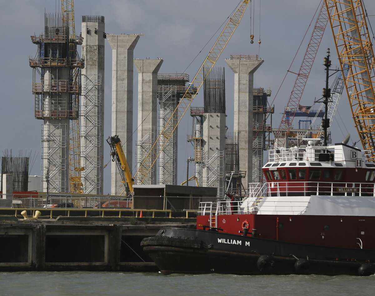 Work progresses as columns of the new Harbor Bridge in Corpus Christi are seen on Tuesday, May 28, 2019. Corpus Christi is becoming a major port for the export of oil from the Permain Basin and The Eagle Ford. One of the big players is NuStar Energy which operates four docks along the Corpus Christi industrial canal. Like many energy storage companies, NuStar is looking forward to the completion of several projects at the canal such as the new Harbor Bridge project which will allow for bigger vessels to pass into the canal and thus can take on more barrels of oil for shipment and a new and larger pipeline which will feed into NuStar's 400-series tank farm. Projects that the new bridge and new pipelines are cementing Corpus Christi as an emerging port of commerce in the energy sector. (Kin Man Hui/San Antonio Express-News)
