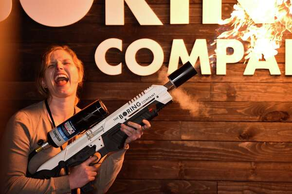An attendee operates a Boring Co. flamethrower at the company's photo booth during an unveiling event for the Boring Co. Hawthorne test tunnel in Hawthorne, California, U.S., on Tuesday, Dec. 18, 2018.