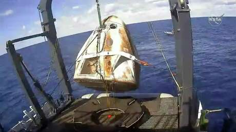 In this March 8 file image made available by NASA, the SpaceX Crew Dragon capsule is hoisted onto a ship off the Florida coast after it returned from the International Space Station. The Dragon was destroyed during a ground test on April 20 at Cape Canaveral, Fla.