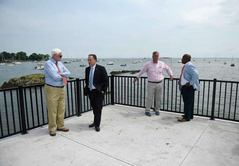From left, Selectman John Toner, First Selectman Peter Tesei, State Rep. Steve Meskers, and Project Manager Sean Cardwell chat on the newly-finished Steamboat Road Scenic Overlook in Greenwich, Conn. Thursday, July 11, 2019. The pier overlooks Greenwich Harbor and features a complete repair of the concrete deck, protective railings, and new parking area with updated handicap parking. The design work was done by Race Coastal Engineering with construction by A. Vitti Excavators for a total cost of $376,848. Photo: Tyler Sizemore / Hearst Connecticut Media / Greenwich Time