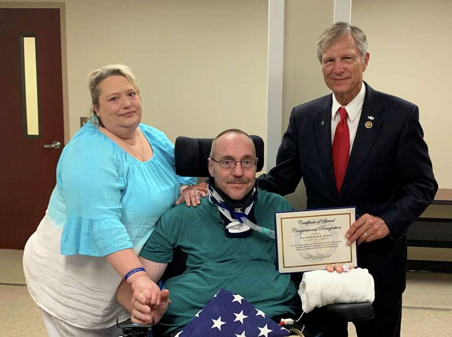 From left to right: Kami Whitten (wife), Deputy Richard Whitten, and Rep. Brian Babin. Photo: Contributed Photo