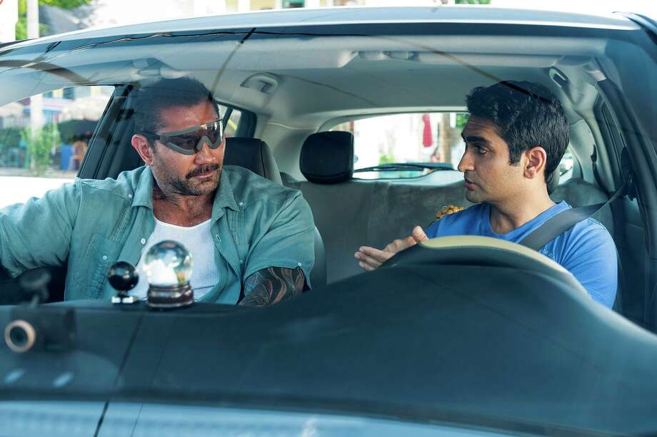 "Dave Bautista, left, plays a police detective recovering from eye surgery, and Kumail Nanjiani is his Uber driver in ""Stuber."" MUST CREDIT: Mark Hill, Twentieth Century Fox Photo: Mark Hill / Twentieth Century Fox / © 2019 Twentieth Century Fox Film Corporation."