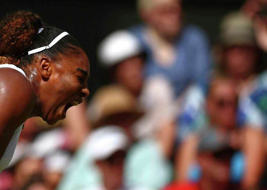 United States' Serena Williams reacts as she plays Czech Republic's Barbora Strycova in a Women's semifinal singles match on day ten of the Wimbledon Tennis Championships in London, Thursday, July 11, 2019. (Hannah McKay/Pool Photo via AP) Photo: Hannah McKay / Copyright 2019 The Associated Press. All rights reserved