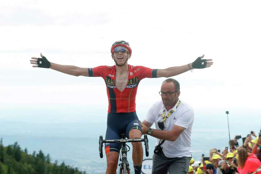 Belgium's Dylan Teuns celebrates as he crosses the finish line to win the sixth stage of the Tour de France cycling race over 160 kilometers (100 miles) with start in Mulhouse and finish in La Planche des Belles Filles, France, Thursday, July 11, 2019. (AP Photo/Thibault Camus)