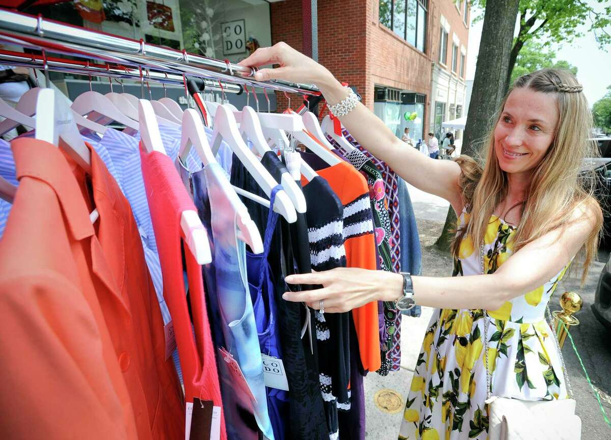 Owner Yulia Omelich of Couture Dossier is photograph on July 11, 2019 at her store on Greenwich Avenue. Her women's fashion business is among the 100 retail businesses participating in the Greenwich Chamber of Commerce Sidewalk Sales Day in Greenwich, Connecticut. The biggest shopping event of the year, super bargains can be found during this shopping extravaganza.