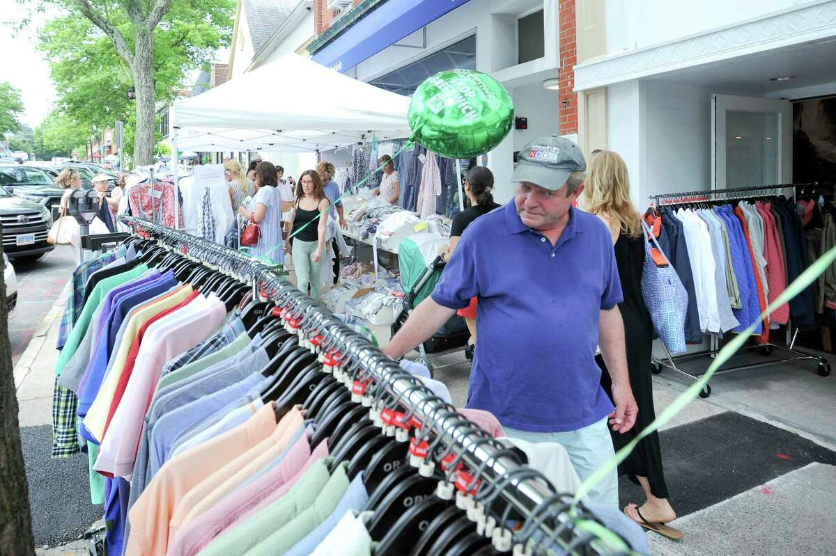 Shoppers hunt for bargains from local retailers as they stroll up and down Greenwich Avenue during Greenwich Chamber of Commerce Sidewalk Sales Day in Greenwich, Conn. on July 11, 2019. The biggest shopping event of the year, with over 100 stores participating in this event, super bargains can be found during this four day shopping extravaganza.