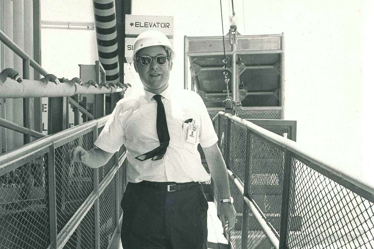Then working as the Science Editor of the Chronicle, Arthur Hill walks down the gantry of the Saturn V rocket that would be used on the Apollo 11 launch.