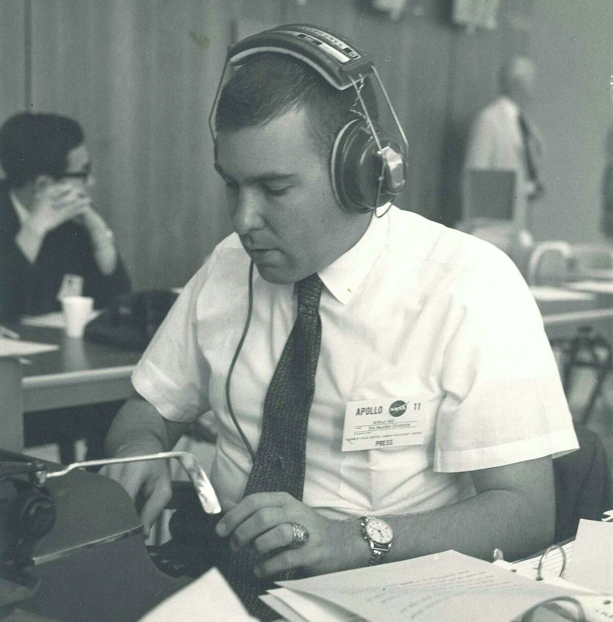 Arthur Hill is shown in this 1969 photo working on coverage of the Apollo 11 mission from the Chronicle's reporting base at Johnson Space Center.