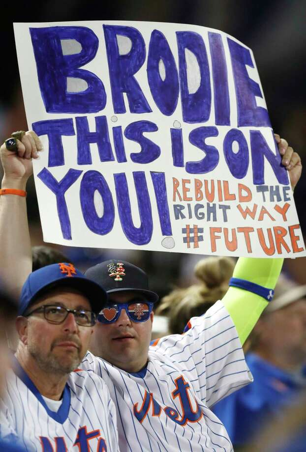 Disgruntled New York Mets fans express their sentiments with a sign for Mets general manager Brodie Van Wagenen during a baseball game against the Atlanta Braves, Sunday, June 30, 2019, in New York. (AP Photo/Kathy Willens) Photo: Kathy Willens / Copyright 2019 The Associated Press. All rights reserved.