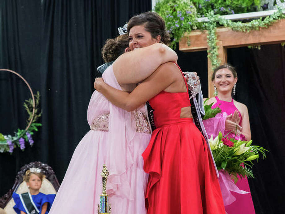 Miss Sara Lamer is crowned Jersey County Fair Queen by last year's queen, Miss Taylor Stocks. Photo: Jody Jedlicka | Photographic Images By Jo, For The Telegraph