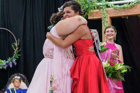 Miss Sara Lamer is crowned Jersey County Fair Queen by last year's queen, Miss Taylor Stocks.