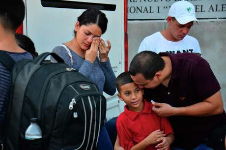 A Cuban family is overwhelmed with emotion as migrants talk about whether their asylum claims might be accepted or rejected, as they prepare in Nuevo Laredo, Mexico, to cross into the U.S.