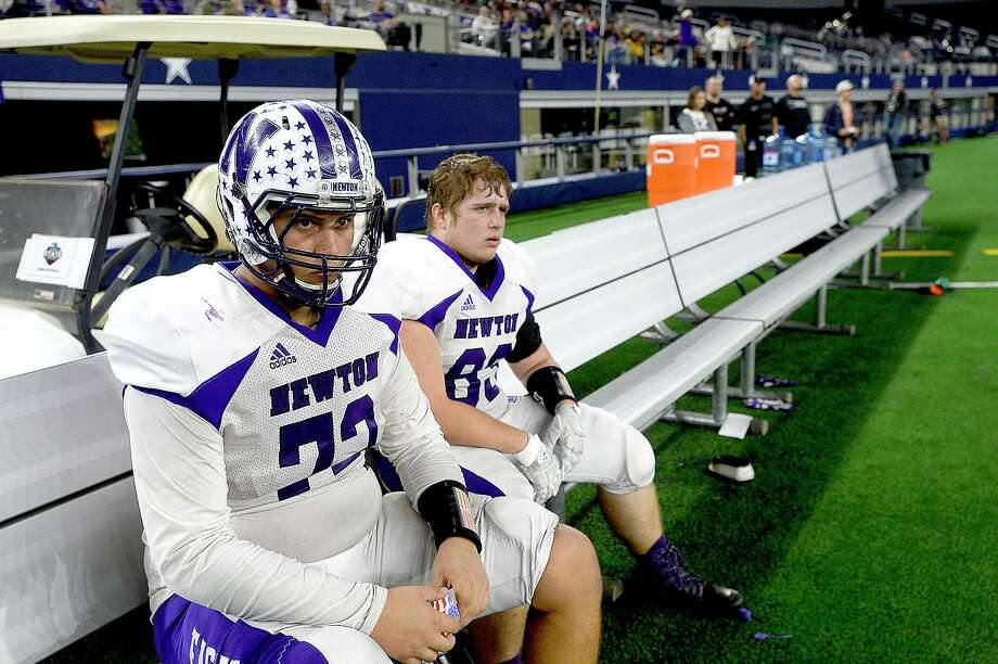 Newton's offesnive linemen Caiden Walker and Colt Burnett react on the sidelines after coming in from a down against Candian during their state final Class 3A Div. II game at AT&T Stadium.