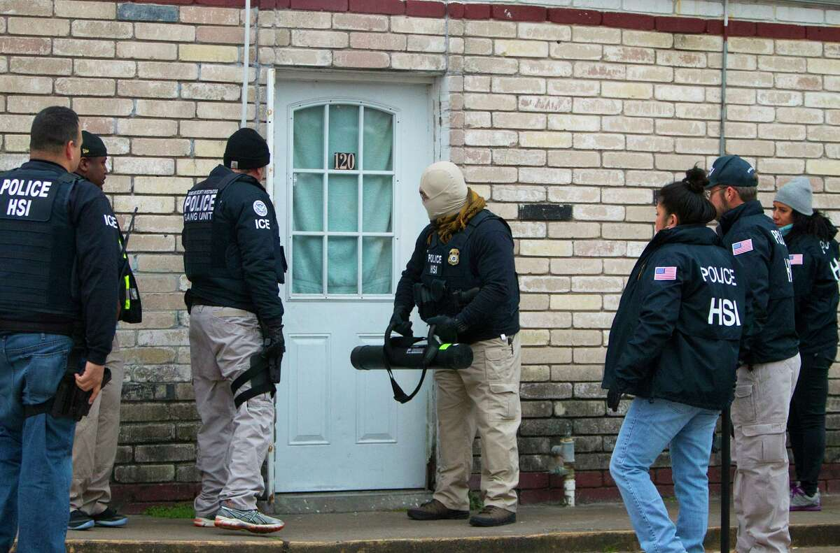 Police arrest suspects after raiding a business in southwest Houston in January 2014. Raids reportedly planned in Houston and other cities starting Sunday differ from previous enforcement efforts in scope and targets, focusing on recently-arrived immigrant families.