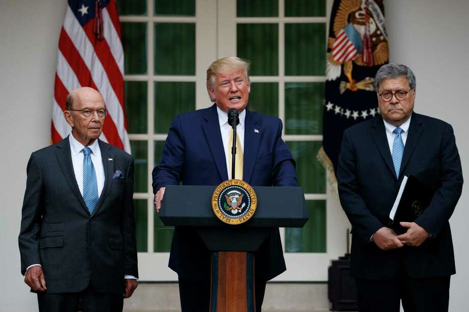 President Donald Trump, joined by Commerce Secretary Wilbur Ross, left, and Attorney General William Barr, speaks during an event about the census in the Rose Garden at the White House in Washington, Thursday, July 11, 2019. (AP Photo/Carolyn Kaster) Photo: Carolyn Kaster / Copyright 2019 The Associated Press. All rights reserved
