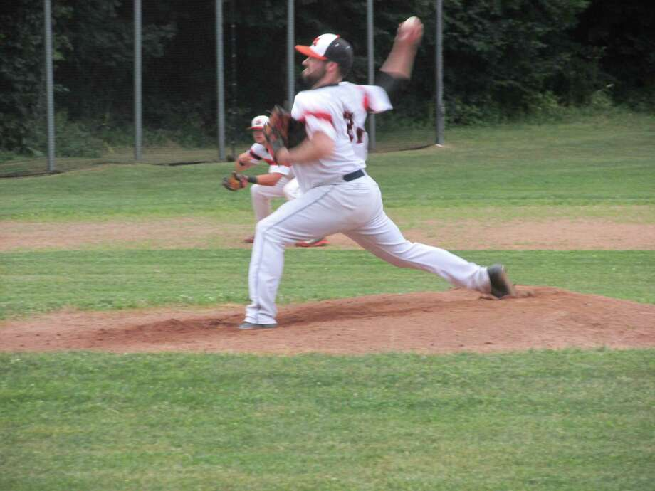 Terryville Black Sox ace Kody Kerski helped jump his team into first place in the Tri-State Baseball League with a 7-1 win over the Tri-Town Trojans Thursday night at the Old Terryville High School. Photo: Peter Wallace / Hearst Connecticut Media
