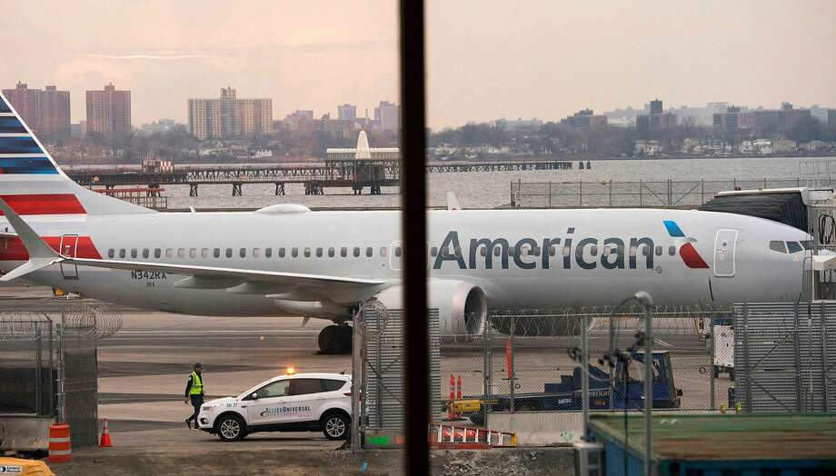 FILE - A woman in Florida is in custody for faking medical problems aboard an American Airlines flight headed to Miami early Friday morning, police say. Photo: Don Emmert, AFP/Getty Images