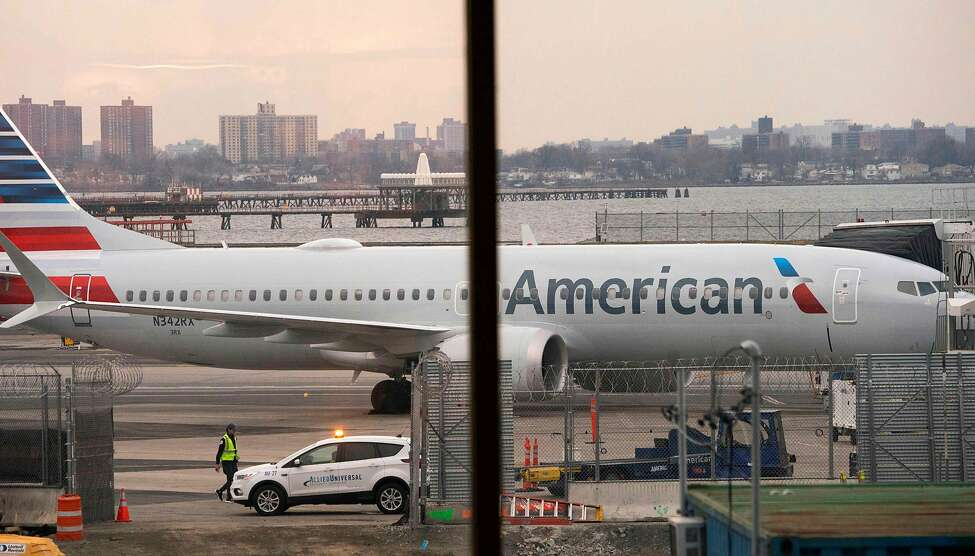 FILE - A woman in Florida is in custody for faking medical problems aboard an American Airlines flight headed to Miami early Friday morning, police say.