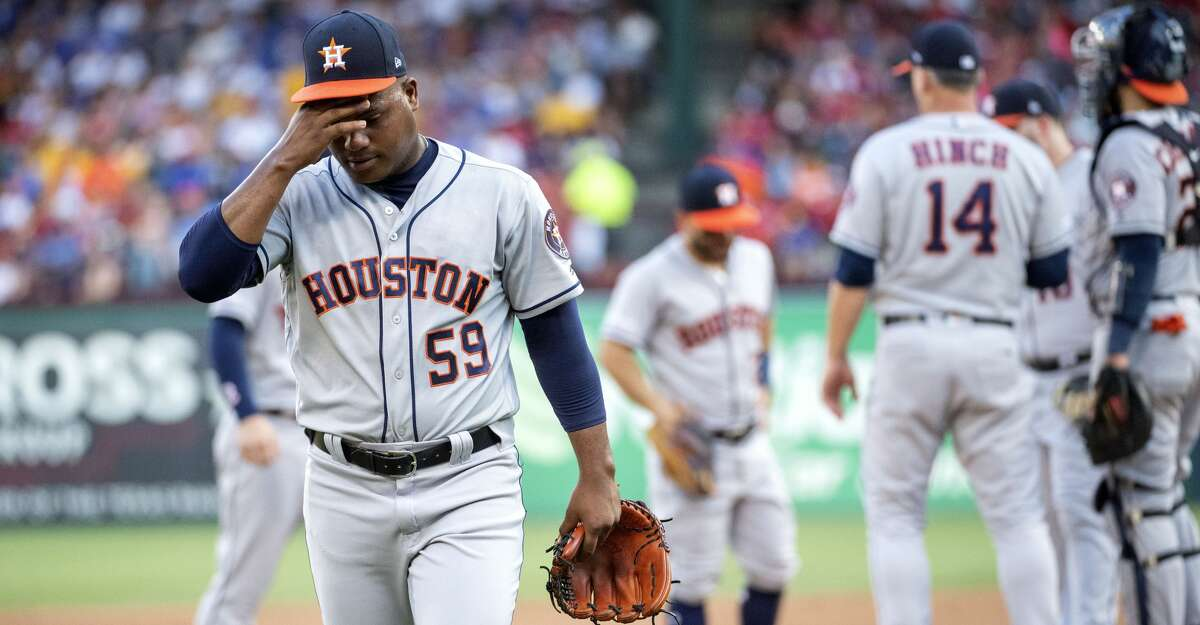 Houston Astros starting pitcher Framber Valdez (59) wipes his brow as he walks back to the dugout after being pulled by manager A.J. Hinch (14) during the first inning of a baseball game Thursday, July 11, 2019, in Arlington, Texas. (AP Photo/Jeffrey McWhorter)