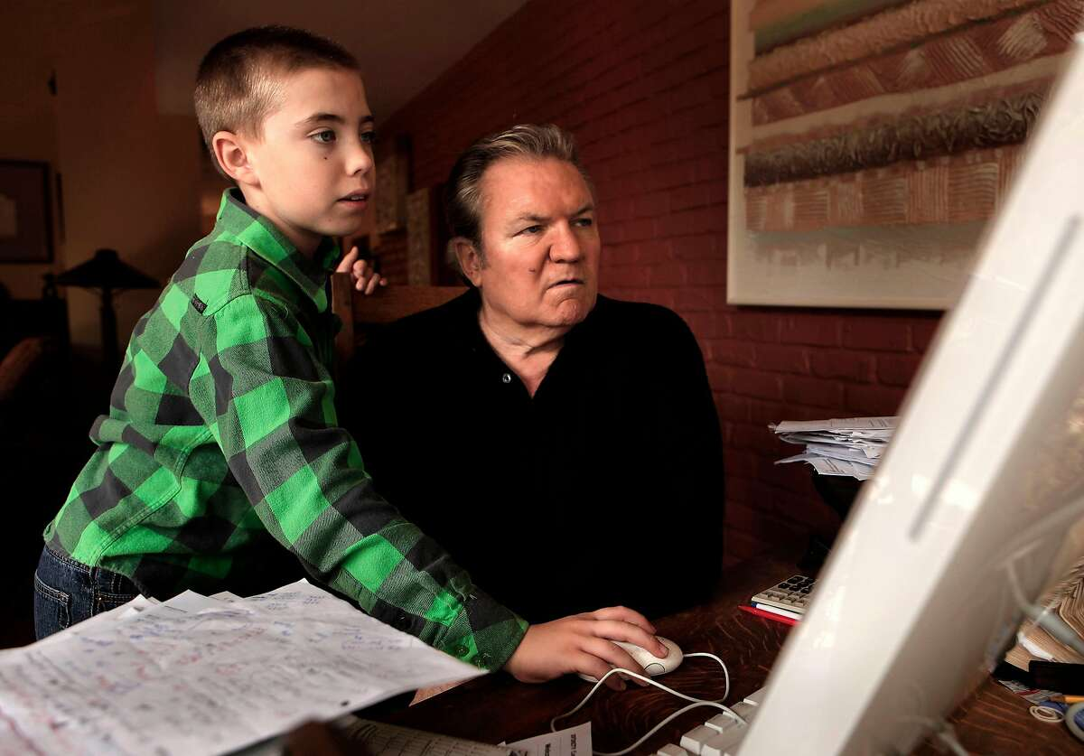 Ralph Barbieri is guided around the internet by his 11-year-old son, Tate at their Novato, Ca. home, Ca. on Saturday October 1, 2011.