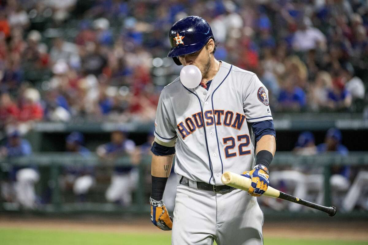 Houston Astros' Josh Reddick (22) blows a bubble after striking out against Texas Rangers relief pitcher Chris Martin during the ninth inning of a baseball game, Thursday, July 11, 2019, in Arlington, Texas. Texas won 5-0. (AP Photo/Jeffrey McWhorter)