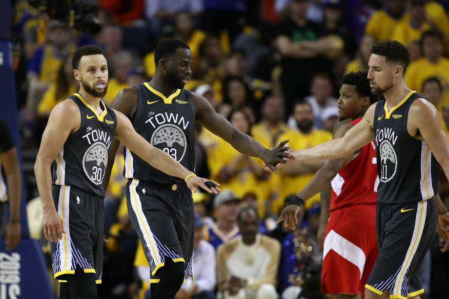 OAKLAND, CALIFORNIA - JUNE 07: Stephen Curry #30, Draymond Green #23 and Klay Thompson #11 of the Golden State Warriors react against the Toronto Raptors in the second half during Game Four of the 2019 NBA Finals at ORACLE Arena on June 07, 2019 in Oakland, California. NOTE TO USER: User expressly acknowledges and agrees that, by downloading and or using this photograph, User is consenting to the terms and conditions of the Getty Images License Agreement. (Photo by Ezra Shaw/Getty Images) Photo: Ezra Shaw/Getty Images