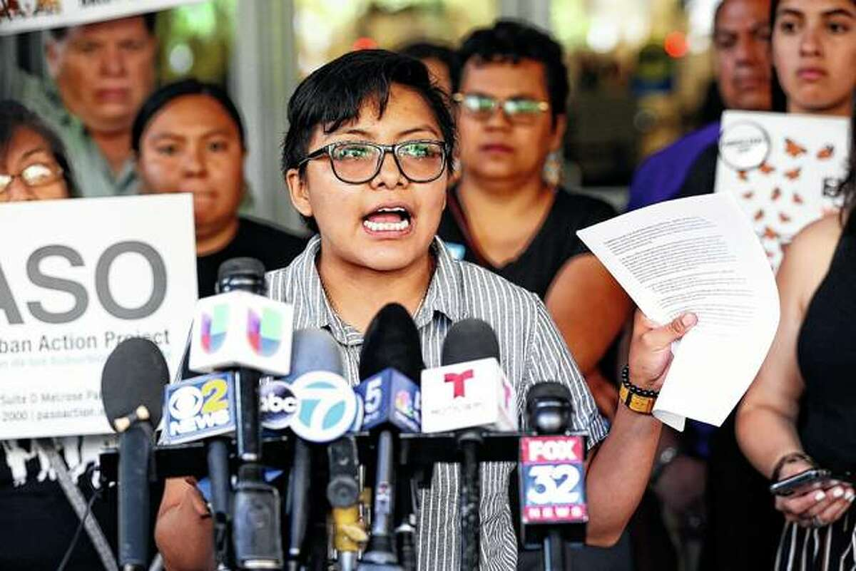 Rey Wences, an organizer at Organized Communities Against Deportations (OCAD), addresses reporters Thursday during a new conference outside U.S. Citizenship and Immigration Services offices in Chicago. A nationwide immigration enforcement operation targeting people who are in the United States illegally is expected to begin this weekend.