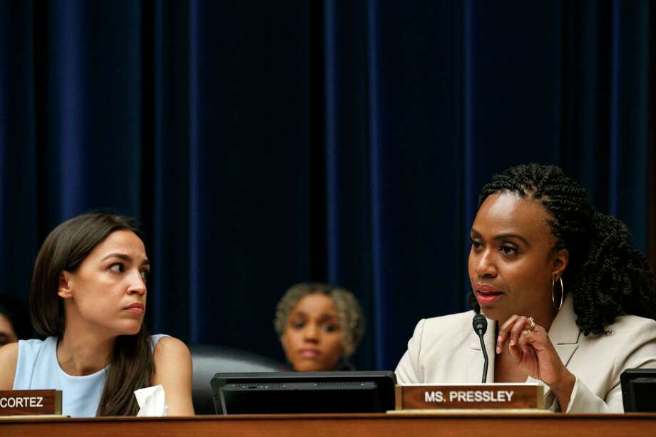 Rep. Alexandria Ocasio-Cortez, D-N.Y., left, listens as Rep. Ayanna Pressley, D-Mass., tells Yazmin Juárez, that she did not cause the death of her daughter Mariee, 1, who died after being released from detention by U.S. Immigration and Customs Enforcement (ICE), as Juárez testified at a House Oversight Civil Rights and Civil Liberties subcommittee hearing on treatment of immigrant children at the southern border, Wednesday, July 10, 2019, on Capitol Hill in Washington. Photo: Jacquelyn Martin, AP / Copyright 2019 The Associated Press. All rights reserved.
