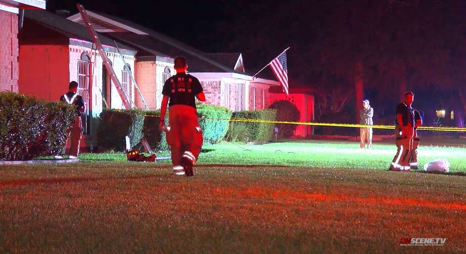 Spring firefighters respond to a house fire on Friday, July 12, in the Lexington Woods subdivision in Spring. A woman was found dead near the back door inside the home. Photo: OnScene TV