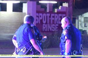 San Antonio police are looking for two men who shot and robbed two others on the city's West Side Friday morning.