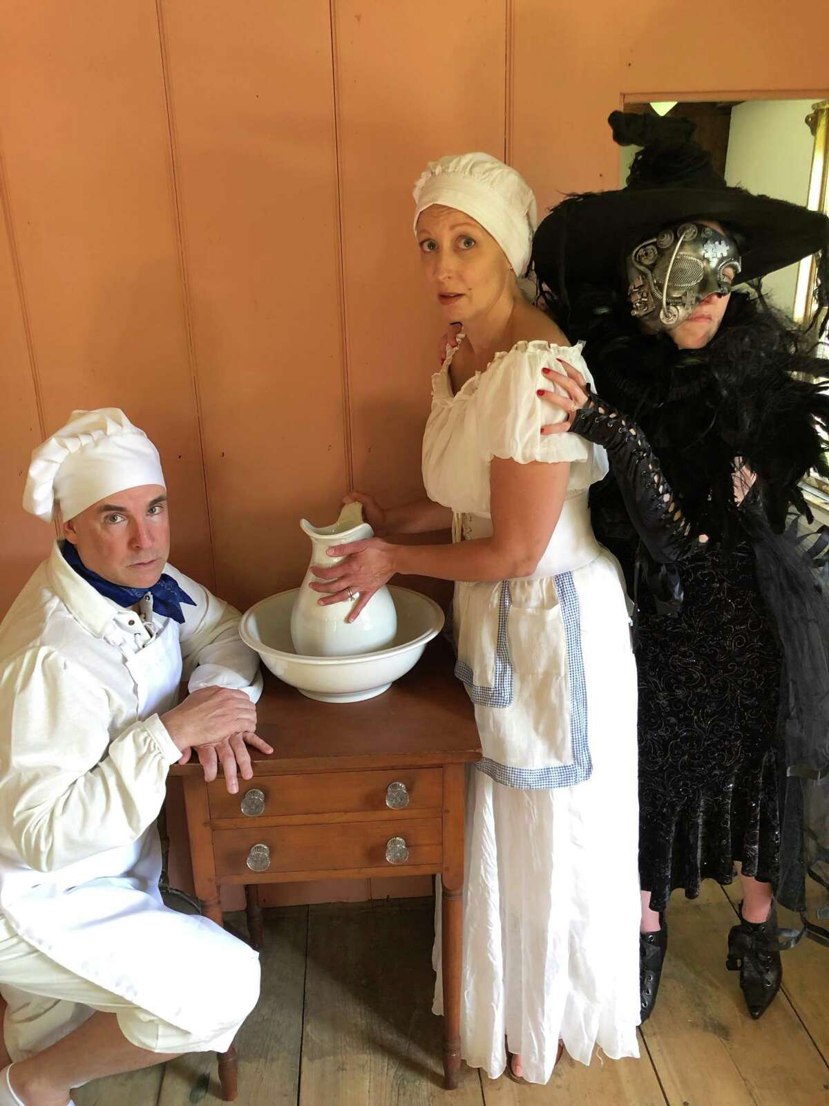 """John Johmann as the Baker, Rebecca Ellis as the Baker's Wife and Joanie Brittingham as the Witch in """"Into the Woods."""""""