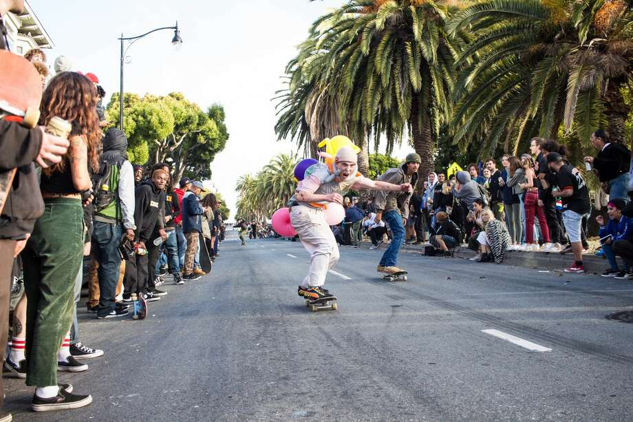 "Hundreds of skateboarders zoomed down a steep section of Dolores Street on July 11, 2019, in an impromptu ""hill bomb."" Photo: Kiara Gil, Instagram: Photo_ki.gil"