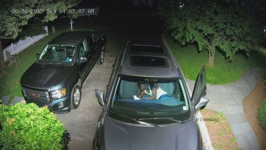 The Darien Police Department is looking for the public's help identifying a man involved with a car burglary. Photo: Contributed Photo / Darien Police Department