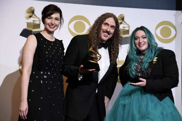"From left, Annie Stoll, ""Weird Al"" Yankovic and Meghan Foley, winners of Best Boxed Or Special Limited Edition Package for ""Squeeze Box: The Complete Works Of 'Weird Al' Yankovic,"" pose in the press room during the Grammy Awards in February."