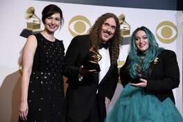 """From left, Annie Stoll, """"Weird Al"""" Yankovic and Meghan Foley, winners of Best Boxed Or Special Limited Edition Package for """"Squeeze Box: The Complete Works Of 'Weird Al' Yankovic,"""" pose in the press room during the Grammy Awards in February."""