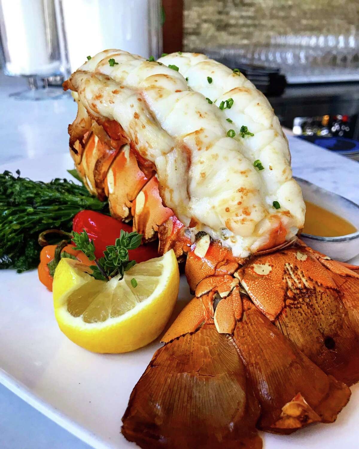 Australian lobster tail with Mediterranean butter baste and grilled vegetables at Ouzo Bay.