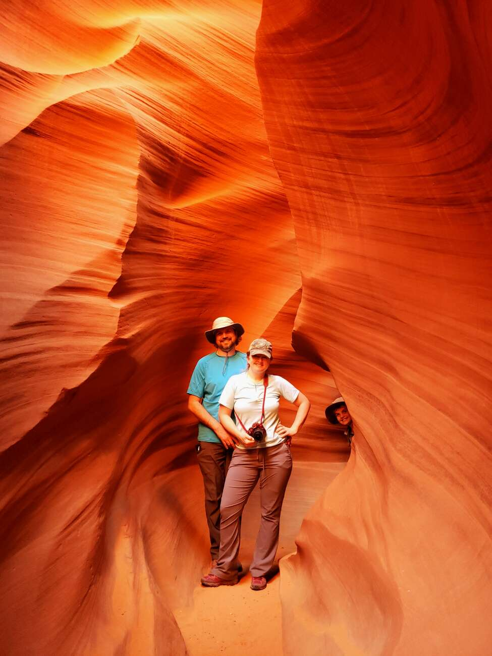 Josh Trombley, Leigh Hornbeck and photo-bomber Rushton Trombley in the Lower Antelope Canyon, Navajo Nation, near Page, Ariz.