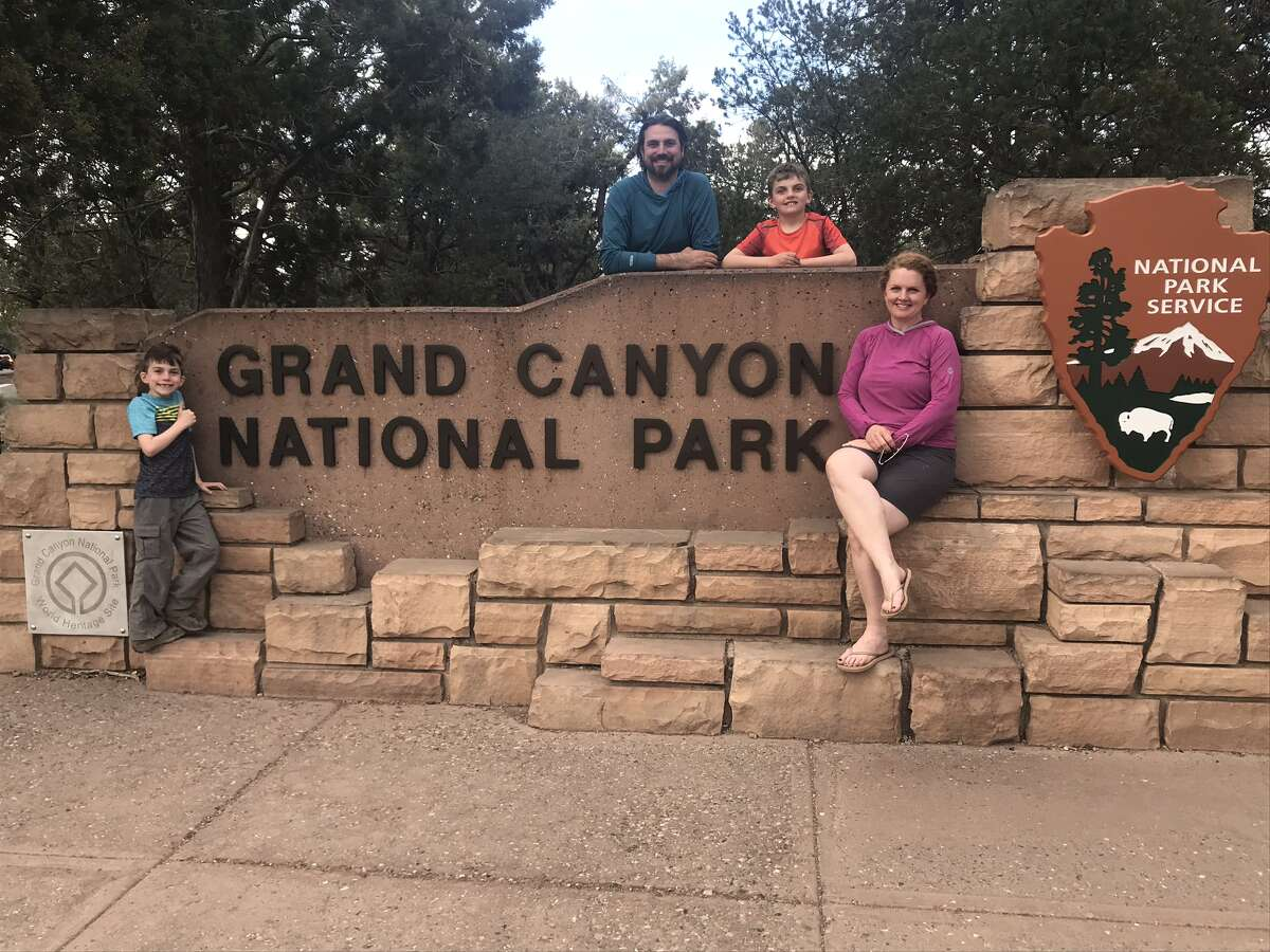 Family portrait at the entrance to the Grand Canyon National park. From left: Devlin, Josh and Rushton Trombley; Leigh Hornbeck.