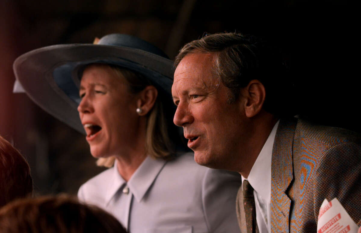 Times Union staff photograph by Skip Dickstein -- Some winners and some losers might be a good lead for this image of Governor George Pataki and Mrs Libby Pataki at the Saratoga Race Course in Saratoga Springs New York , August 27, 1999. They react to the 6th race winner and loser.