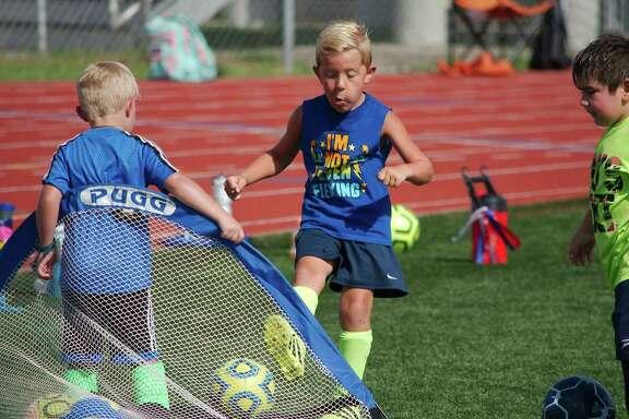 Hayes Miller kicks the ball in the net during the Pearland summer soccer camp at The Rig.