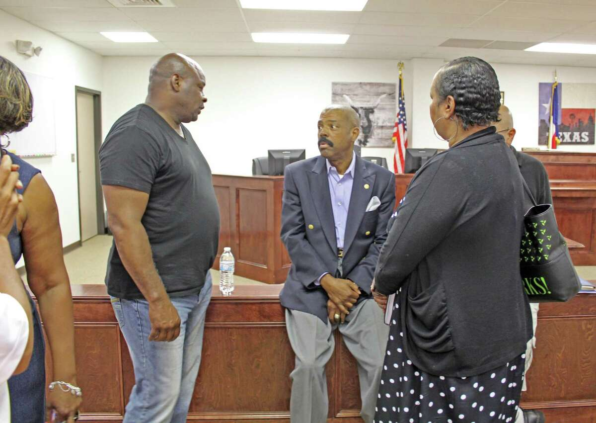 Senator Borris Miles (seated at center) talks with guests at a town hall meeting held in Missouri City on Wednesday, July 10.