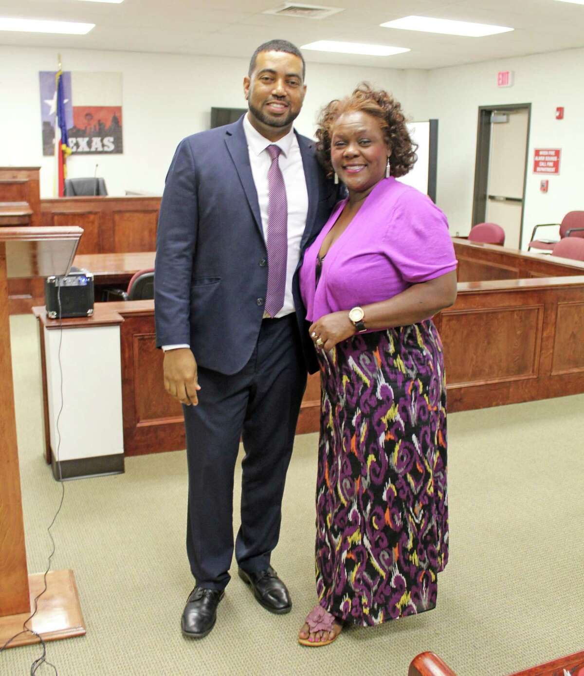 Fort Bend County District Attorney Brian Middleton (left) and Cynthia Ginyard, chair of Fort Bend County Democratic Party (right) were among the guests at a Missouri City Town Hall hosted by Senator Borris Miles on Wednesday, July 10.