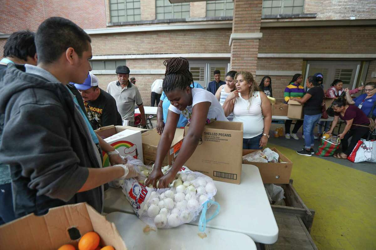 """In this May file photo, Wheatley High School Army JROTC students help with a market with food from the Houston Food Bank at their campus. Wheatley is one of four schools that must receive a """"C"""" grade or better in 2019 or 2020 under the state's academic accountability system to avoid triggering major sanctions."""