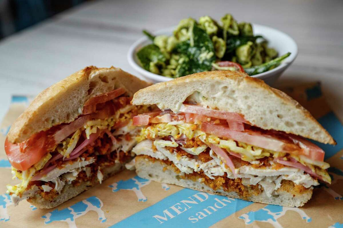 """The """"Not So Fried"""" Chicken sandwich: roasted chicken breast topped with Mendo's krispies, herb aioli, mustard pickle slaw, tomatoes, pickled red onions, on toasted ciabatta at Mendocino Farms."""