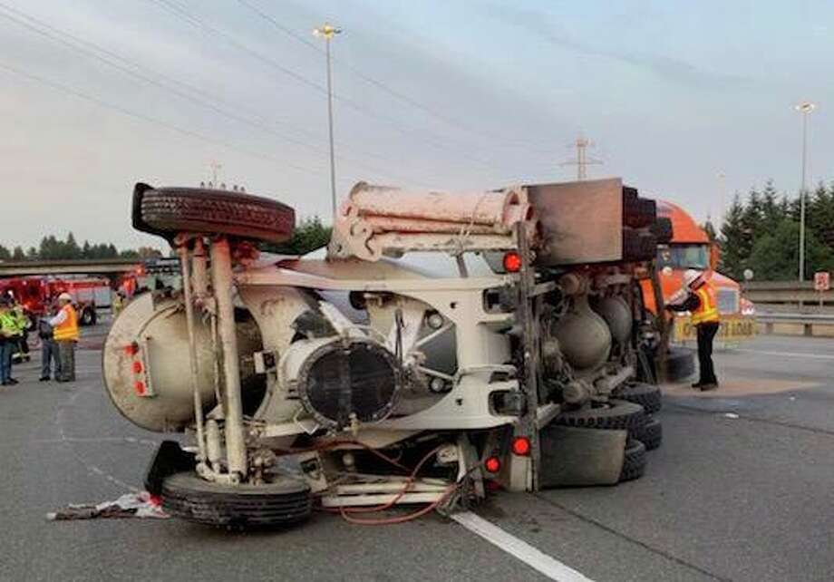 A speeding concrete mixer truck rolled over in Lynnwood Friday morning on the ramp between northbound Interstate 405 and northbound Interstate 5. Two lanes were blocked until the crashed cement truck could be towed. Photo: Courtesy South Snohomish County Fire