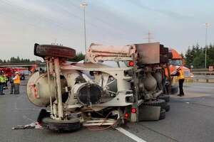 A speeding concrete mixer truck rolled over in Lynnwood Friday morning on the ramp between northbound Interstate 405 and northbound Interstate 5. Two lanes were blocked until the crashed cement truck could be towed.