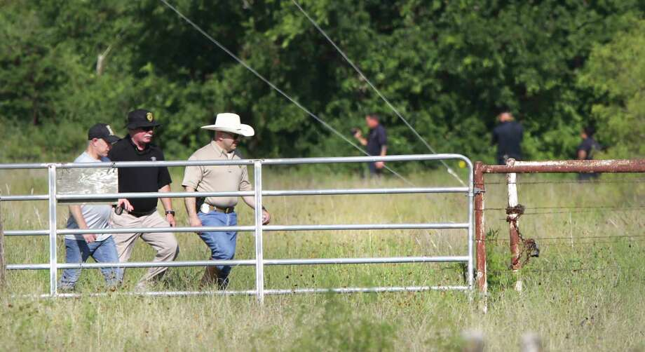 Bexar County Sheriff Javier Salazar, center right, walks away after inspecting the site where human skeletal remains have been found on a ranch near 680 Specht Rd, on Friday, July 12, 2019. Photo: Bob Owen, Staff Photographer / ©2019 San Antonio Express-News