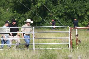 Bexar County Sheriff Javier Salazar, center right, walks away after inspecting the site where human skeletal remains have been found on a ranch near 680 Specht Rd, on Friday, July 12, 2019.